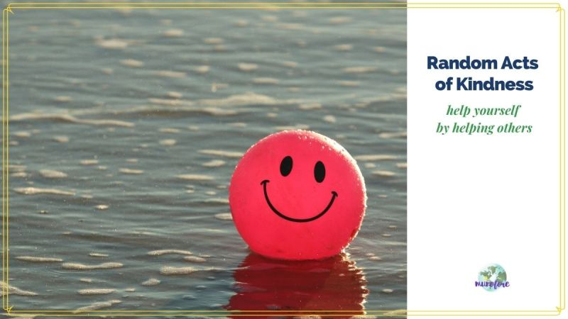 "ball with smiley face floating on water with text overlay ""Random Acts of Kindness help yourself by helping others"