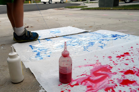 child squeeze bottle painting outside