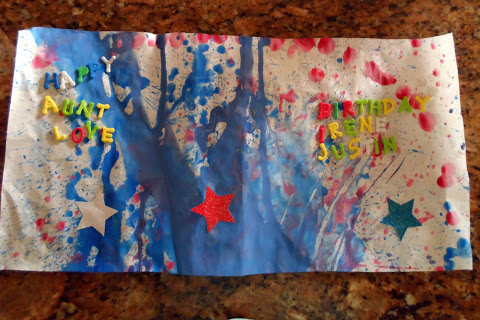 giant poster card made with stickers and paint