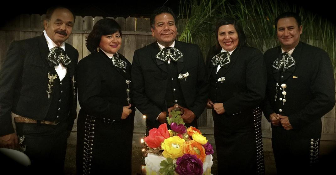Members of Mariachi Universal group pose with instruments.