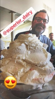 Photograph of Donald Munro in front of a giant ice cream sundae at Superior Dairy.