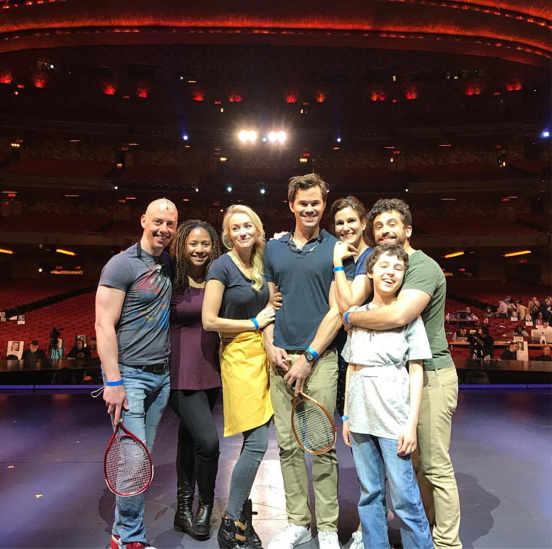 Photograph of the cast of 'Falsettos' on stage.