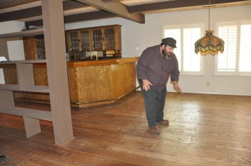 Real wooden floors? Tevye checks out the merchandise.