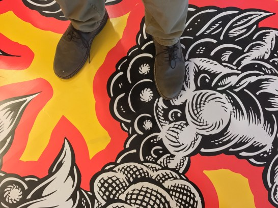 """Walkable art: Standing on Mark Dean Veca's """"The Maddest Hatter."""" Photo / The Munro Review"""