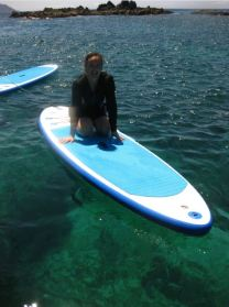 Sheryl getting comfortable on her paddle board