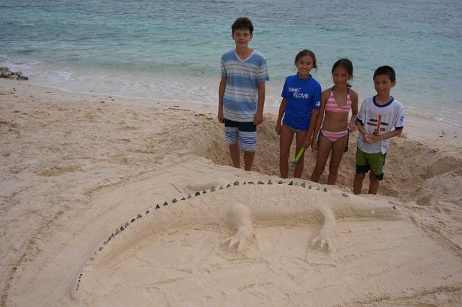 Family fun on beach in Bangka Island