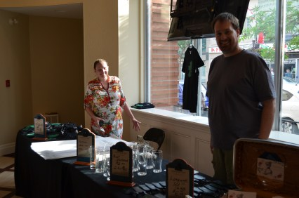 Rebecca and Kirk taking charge of the merchandise!