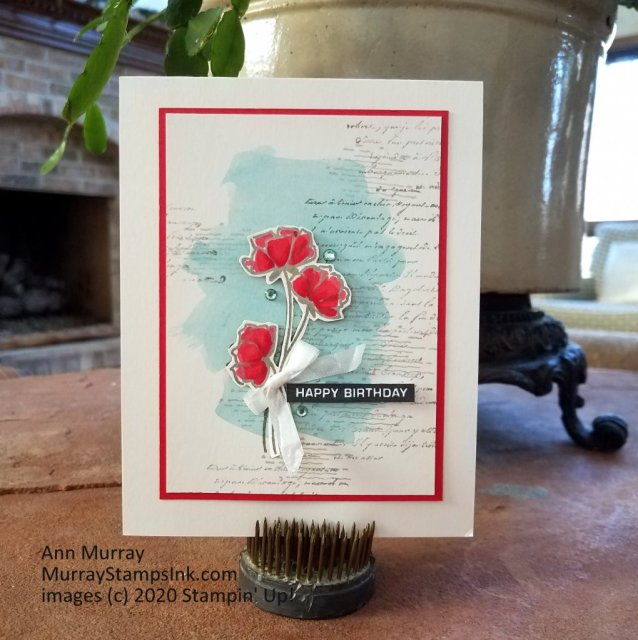 3 simple flower stems on a watercolor and scripty background