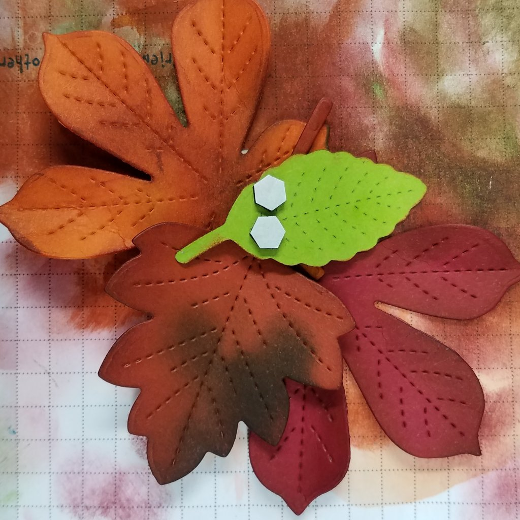 die-cut autumn leaves and inking