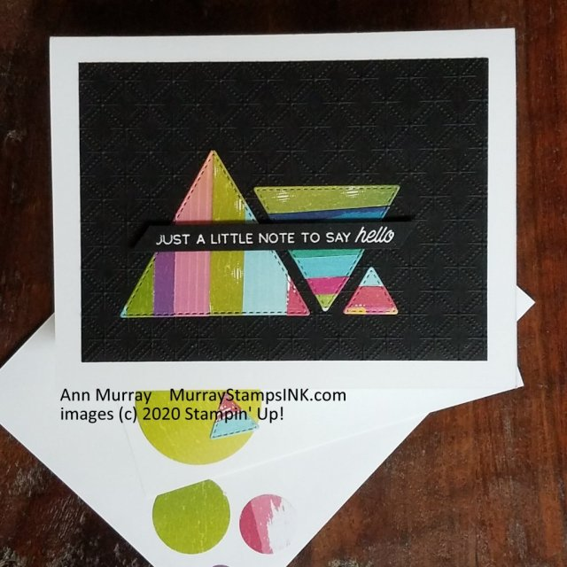 strips of patterned paper die-cut into triangles