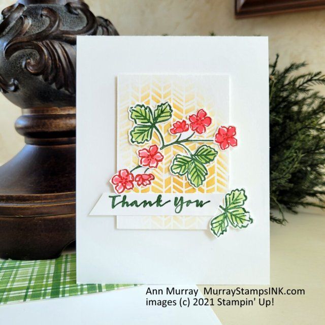 strawberry flowers on a stenciled background