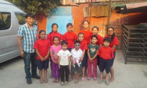 Pem Dorjee Sherpa, volunteer for Tsering's Fund, with sponsored girls from Chyangba Village