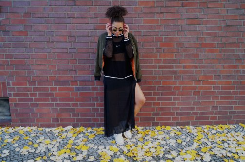 Bomber Jacket: Parisian Collection   Mesh Top: Sweewë   SportsBra: Nike  Slotted Skirt: H&M   Cut Out Boots: Jeffrey Campbell 
