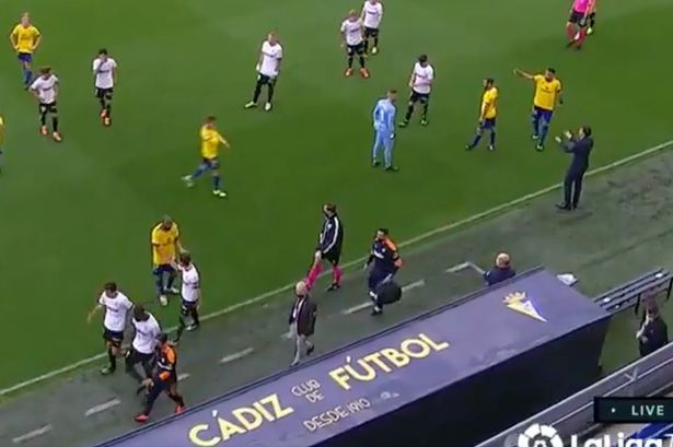 The players leave the pitch after the incident