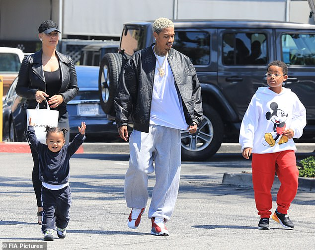 Blended family: Amber Rose and boyfriend Alexander 'AE' Edwards stepped out with their son Slash Electric, two, and her eight-year-old little boy Sebastian in Bel-Air on Tuesday