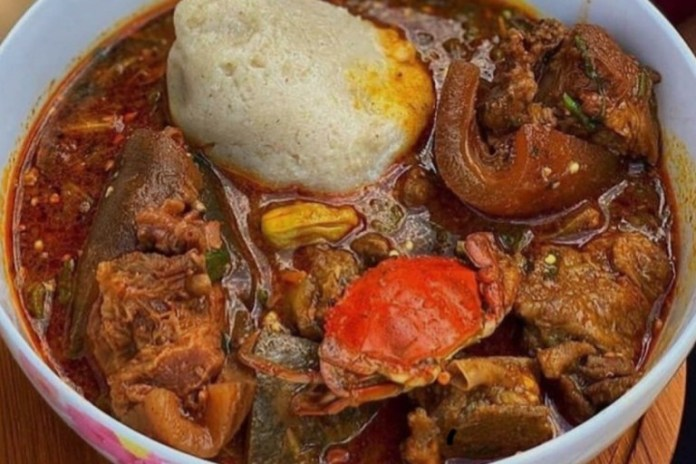 Ghanaian guy prepares banku and okro with GHC 16