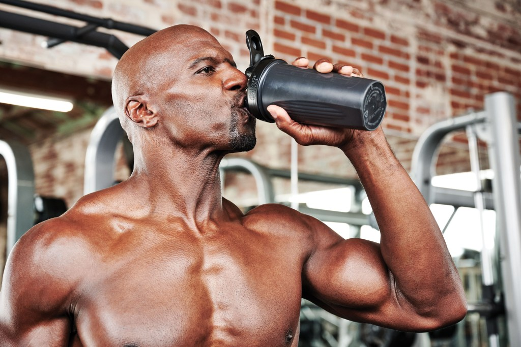 Terry Crews drinking his post workout shake