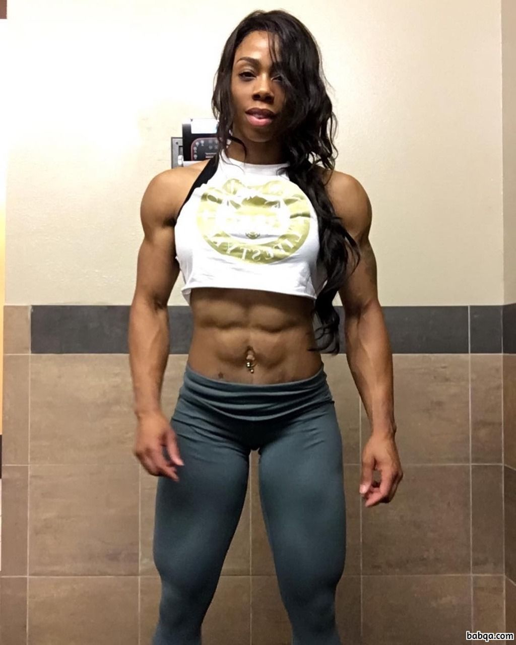 spicy female bodybuilder with muscular body and toned arms ...