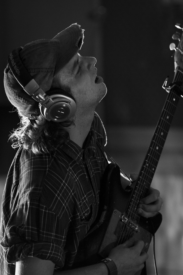 guitar player in recording studio in black and white
