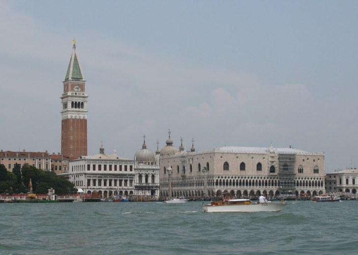 Doges Palace and St Marks Square, Venice. Taken from a vaporetto on my way to the curious island of San Servelo to present at a conference. The conference was fine. The night out with some Scandinavian delegates afterwards was much better though. So good that they missed the last vaporetto back to their hotel...which was on another island!