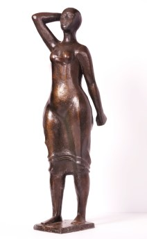 """Elizabeth Catlett, American (born 1915), """"Standing Woman,"""" 1987, bronze, 33 x 9½ x 7 inches, Gift of Drs. William and Camille Cosby, 1987.1"""