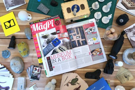 photo of the Raspberry Pi magazine on our work table surrounded by boxes and objects and other office detritus
