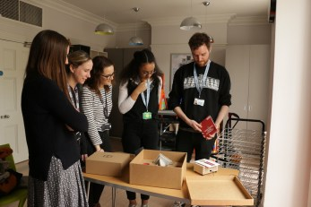 Jewish Museum team checking out the box