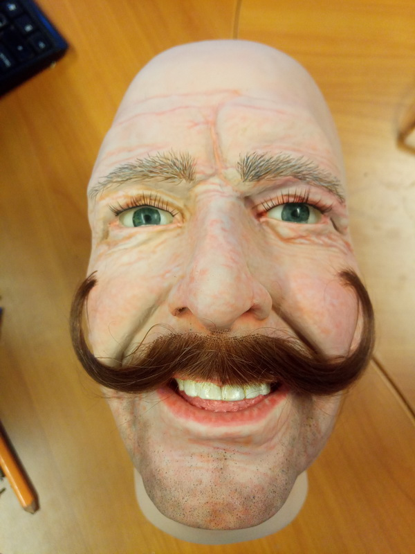 Display mannequin head with handlebar style moustache