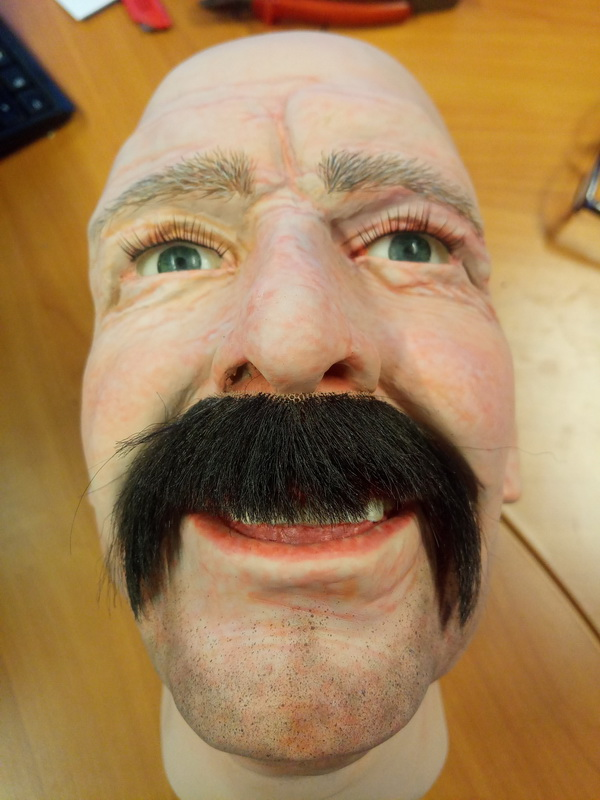 Display mannequin head with brown horseshoe style moustache