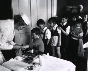 Children are vaccinated with the BCG vaccine.  WHO image, US National Library of Medicine A014051.