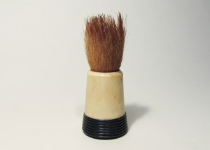 """A shaving brush dating to the nineteenth century. The brush pictured here is made of """"pure badger hair"""" as indicated on its handle. Museum of Health Care #1980.18.115"""