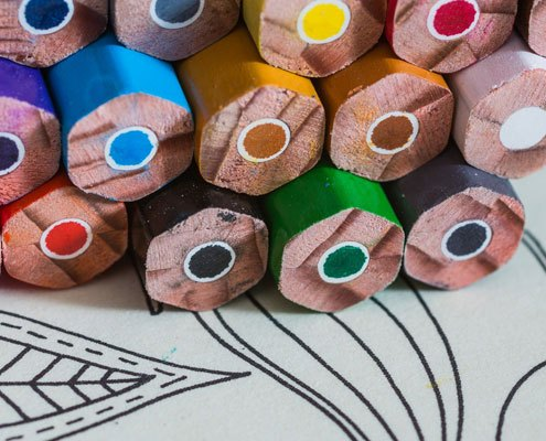 Colouring pencils and book