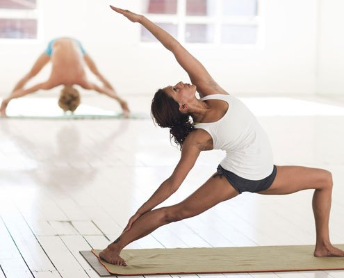 A lady doing a yoga pose
