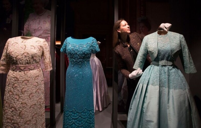 Royal Collection Trust curator Caroline de Guitaut in the exhibition 'Fashioning a Reign: 90 Years of Style from The Queen's Wardrobe' at the Palace of Holyroodhouse, 21 April - 16 October 2016. Royal Collection Trust / (C) Her Majesty Queen Elizabeth II 2016.