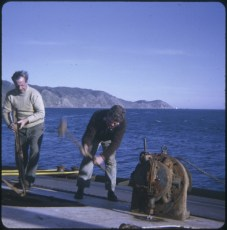Two men on the TEV Wahine wreck during the salvage operation