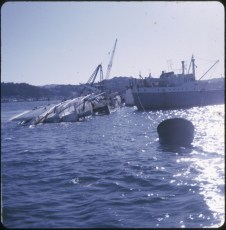 The salvage vessel Holmpark along side of the TEV Wahine wreck.