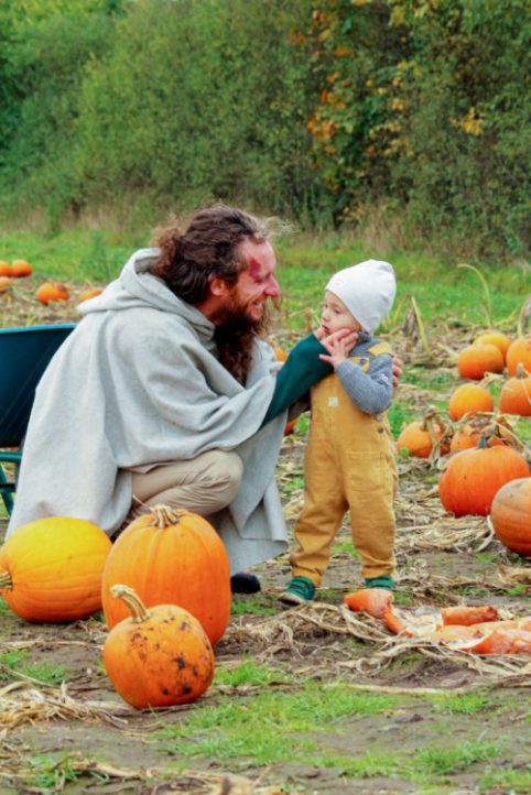 dad and son on a pumpkin field
