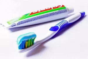 What does the color code on toothpaste tube suggests?