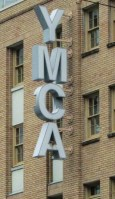 In keeping with the spirit of welcoming the needy, the YMCA sign even has a bird's nest in the A's hole.