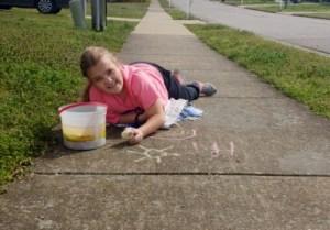 chalk writing on sidewalk