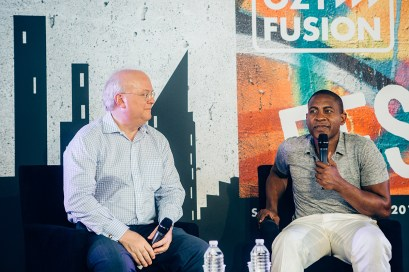 Karl Rove and Carlos Watson at OZY Fusion Festival 2016 by Coen Rees