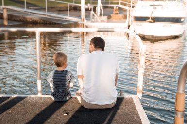 Father and Son on a jetty sitting