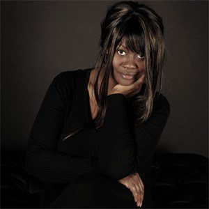 Hire Female Black Jazz Singer in London - Solo Vocalist Pianist