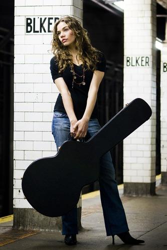 natalie g with guitar standing