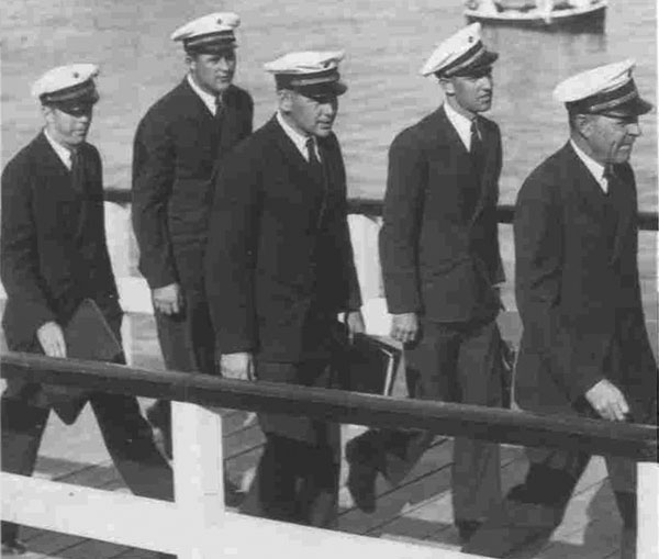 Captain Edwin Musick leads his crew ashore in Auckland in 1937.