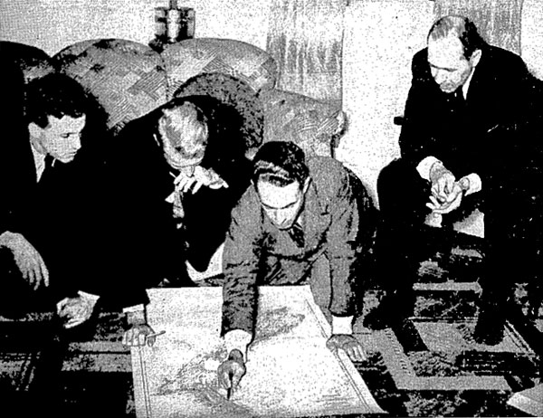 Pan American Airways staff discussing further flights of the Clipper after arrival at Auckland