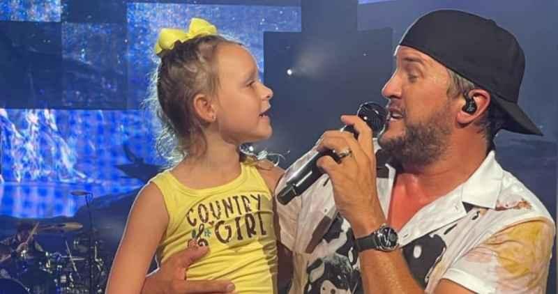 Luke Bryan & 7-year-old fan Darci Claire; Photo by Allison Hintosh