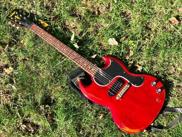 Vintage brand Gibson tribute SG guitar