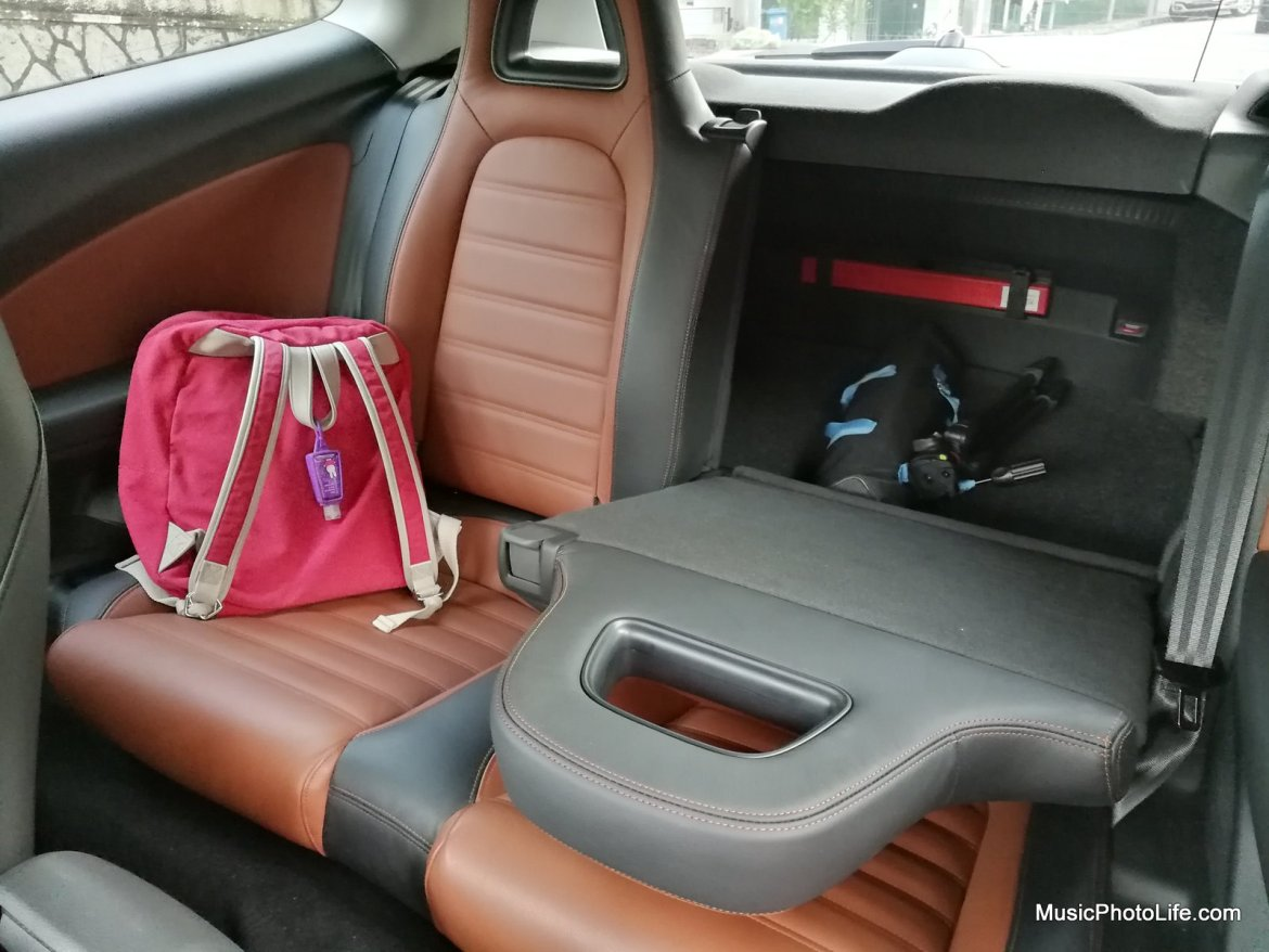 The rear seats can be folded to allow more storage space. Definitely enough to shop for a week's worth of groceries. If you seriously need more boot space, perhaps you can consider removing the spare tyre.