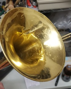 Creased Trumpet Bell Music Time Academy Repair Shop Rental brass and wood wind band instrument